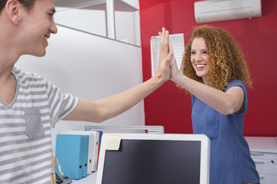 Two students give each other a high five